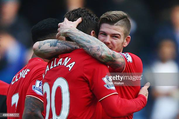 Alberto Moreno and Adam Lallana of Liverpool celebrate their team's 31 win in the Barclays Premier League match between Chelsea and Liverpool at...