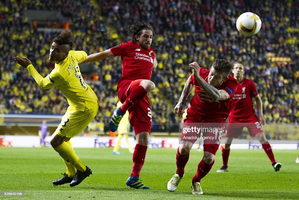 Alberto Moreno (C) and Adam Lallana (R) of Liverpool in action during the UEFA Europa League Semi Final match between Villarreal and Liverpool at Estadio El Madrigal in Villareal, Spain on April 28, 2016.