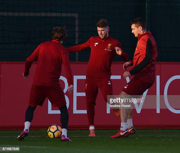 Alberto Moreno and Dejan Lovren of Liverpool during a training session at Melwood Training Ground on November 16 2017 in Liverpool England