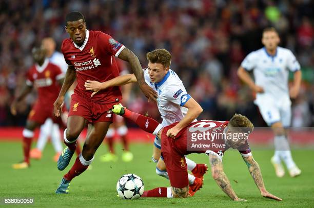 Alberto Moreno and Georginio Wijnaldum of Liverpool competes with Dennis Geiger of 1899 Hoffenheim during the UEFA Champions League Qualifying...