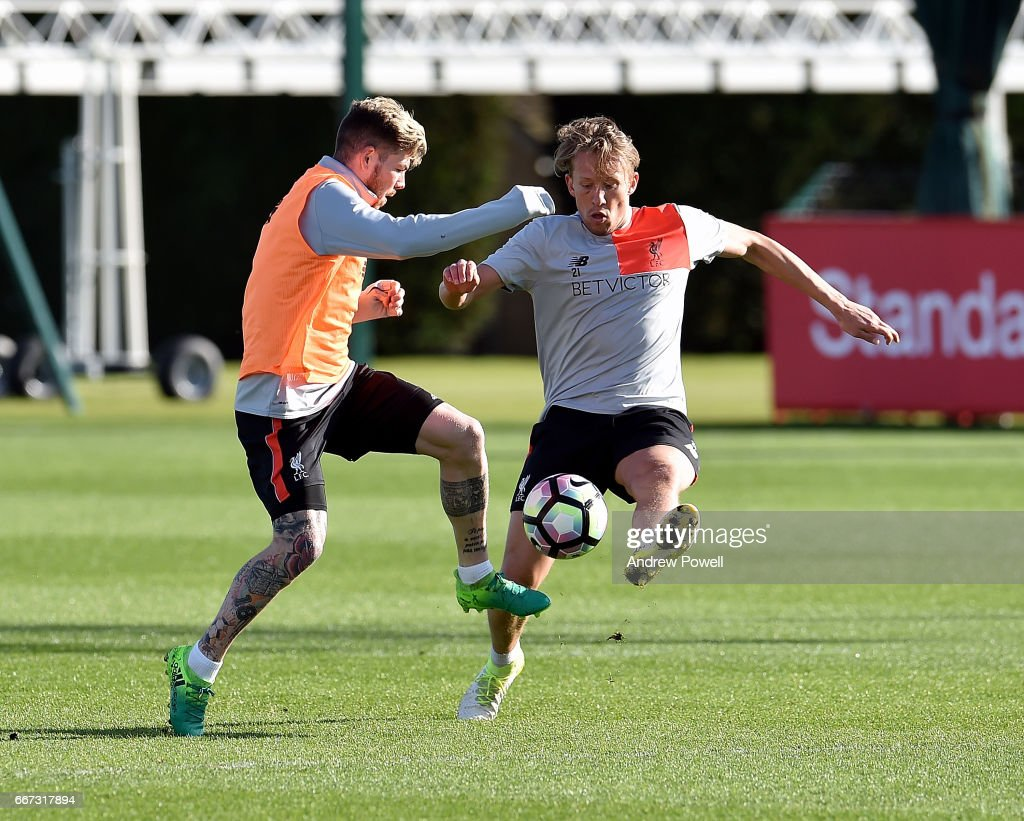 Alberto Moreno and Lucas Leiva of Liverpool during a training session at Melwood Training Ground on April 11, 2017 in Liverpool, England.