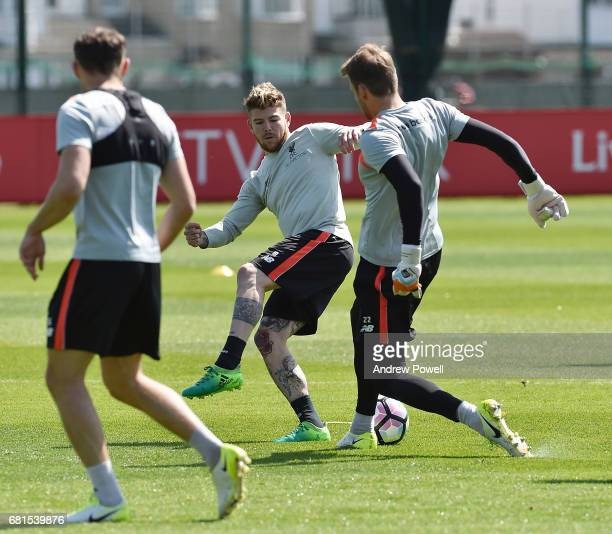 Alberto Moreno and Simon Mignolet of Liverpool during a training session at Melwood Training Ground on May 10 2017 in Liverpool England