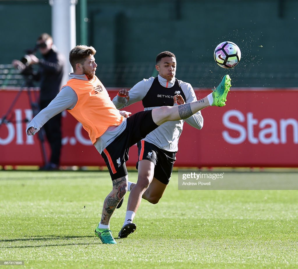 Alberto Moreno and Trent Alexander-Arnold of Liverpool during a training session at Melwood Training Ground on April 11, 2017 in Liverpool, England.