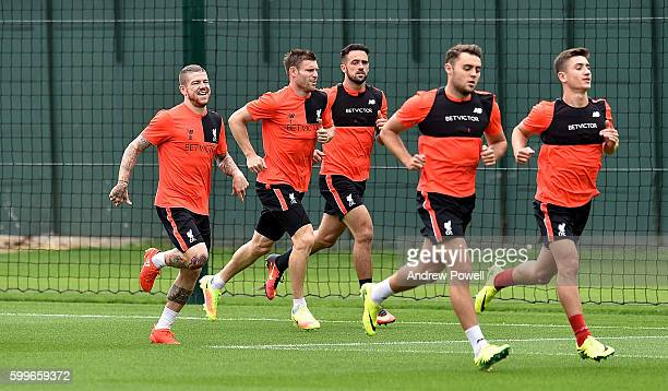 Alberto Moreno James Milner Danny Ings Connor Randall and Cameron Brannagan of Liverpool during a training session at Melwood Training Ground on...
