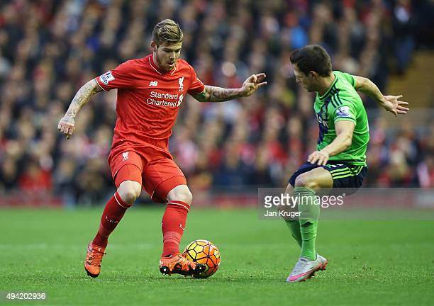 Alberto Moreno of Liverpool and Cedric Soares of Southampton compete for the ball during the Barclays Premier League match between Liverpool and...