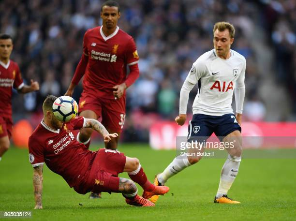 Alberto Moreno of Liverpool and Christian Eriksen of Tottenham Hotspur battle for possession during the Premier League match between Tottenham...