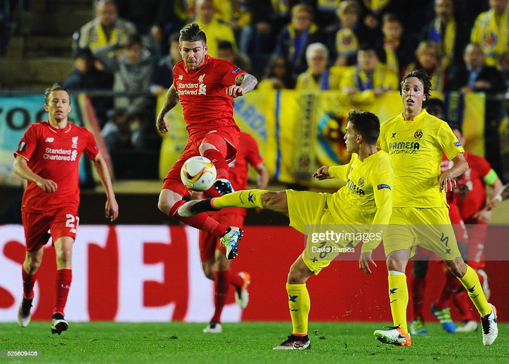 Alberto Moreno of Liverpool and Denis Suarez of Villarreal challenge for the ball during the UEFA Europa League semi final first leg match between Villarreal CF and Liverpool at Estadio El Madrigal on April 28, 2016 in Villarreal, Spain.