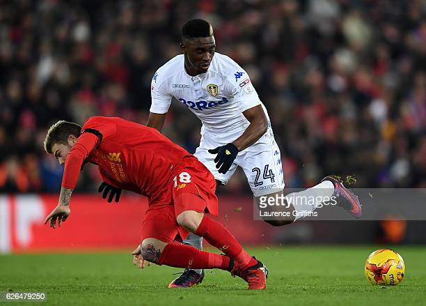 Alberto Moreno of Liverpool and Hadi Sacko of Leeds United battle for the ball during the EFL Cup QuarterFinal match between Liverpool and Leeds...