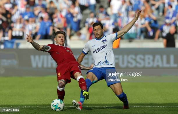 Alberto Moreno of Liverpool battles for the ball with Mathew Leckie of Berlin during the pre season friendly match between Hertha BSC and FC...