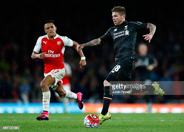 Alberto Moreno of Liverpool breaks away from Alexis Sanchez of Arsenal during the Barclays Premier League match between Arsenal and Liverpool at the...