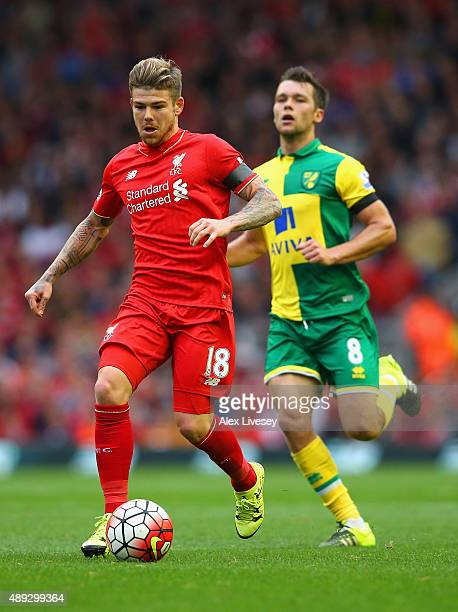 Alberto Moreno of Liverpool breaks with the ball during the Barclays Premier League match between Liverpool and Norwich City at Anfield on September...