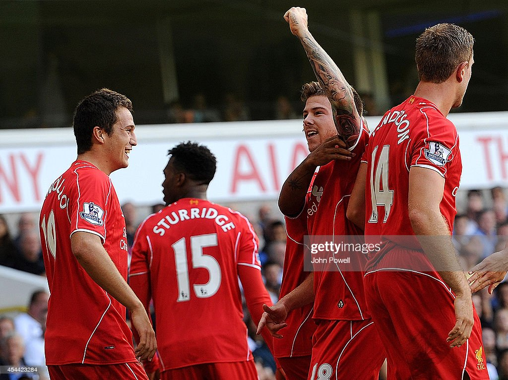 Alberto Moreno of Liverpool celebrates after scoring a goal during the Barclays Premier League match between Tottenham Hotspur and Liverpool at White Hart Lane on August 31, 2014 in London, England.