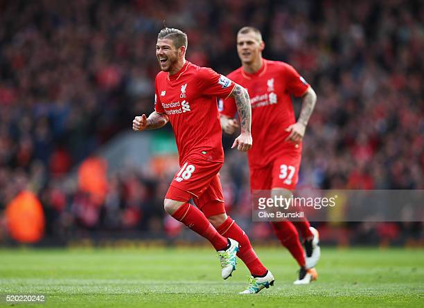 Alberto Moreno of Liverpool celebrates as he scores their first goal during the Barclays Premier League match between Liverpool and Stoke City at...