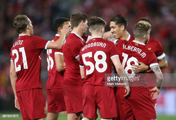 Alberto Moreno of Liverpool celebrates scoring a goal with team mates during the International Friendly match between Sydney FC and Liverpool FC at...