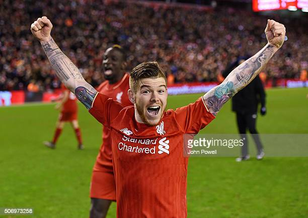 Alberto Moreno of Liverpool celebrates the win at the end of the Capital One Cup Semi Final Second Leg between Liverpool and Stoke City at Anfield on...