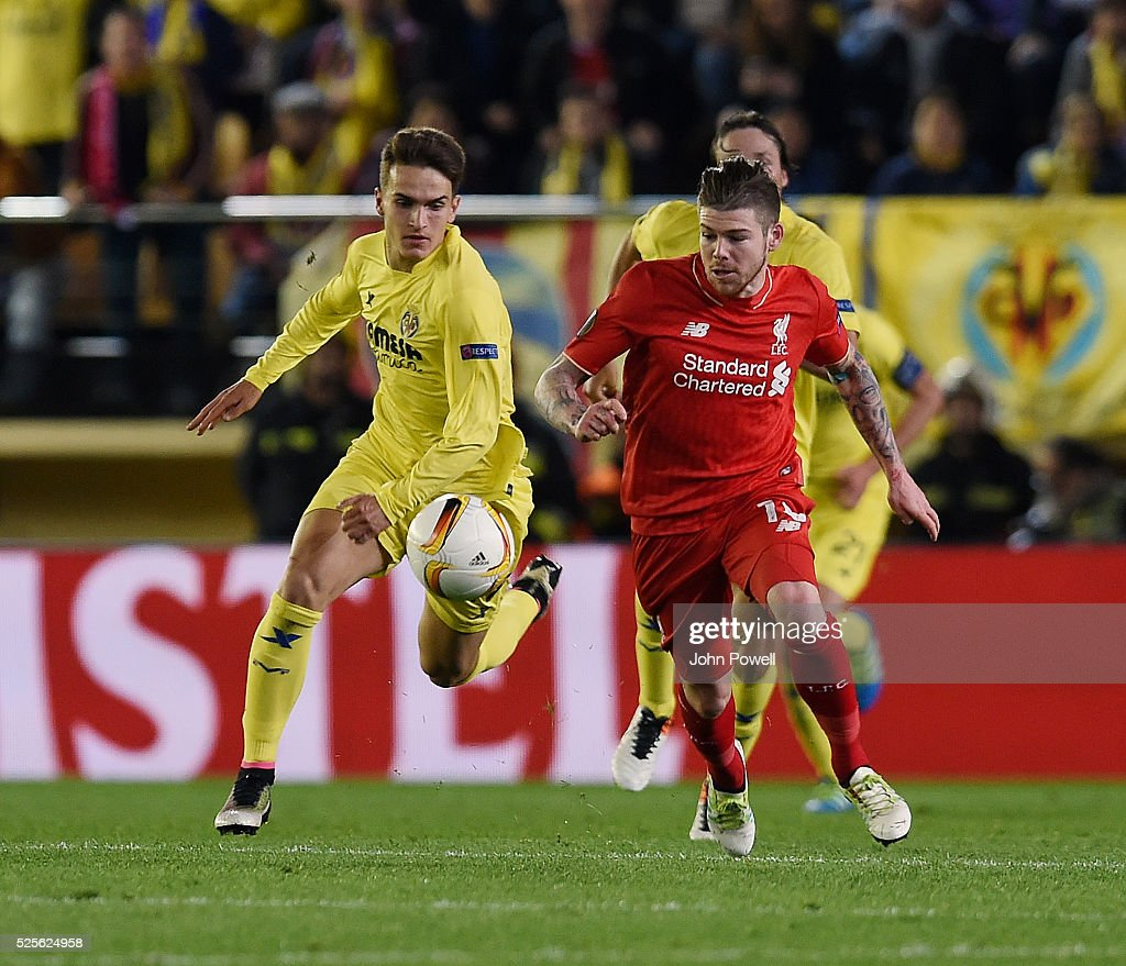 Alberto Moreno of Liverpool competes with Denis Suarez of Villarreal during the UEFA Europa League Semi Final: First Leg match between Villarreal CF and Liverpool on April 28, 2016 in Villarreal, Spain.
