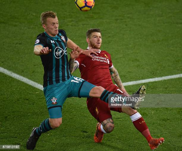 Alberto Moreno of Liverpool competes with James WardProwse of Southampton during the Premier League match between Liverpool and Southampton at...