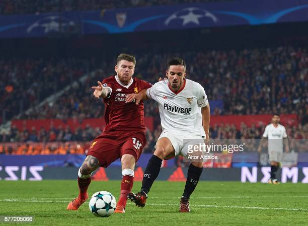 Alberto Moreno of Liverpool FC competes for the ball with Pablo Sarabia of Sevilla FC during the UEFA Champions League group E match between Sevilla...