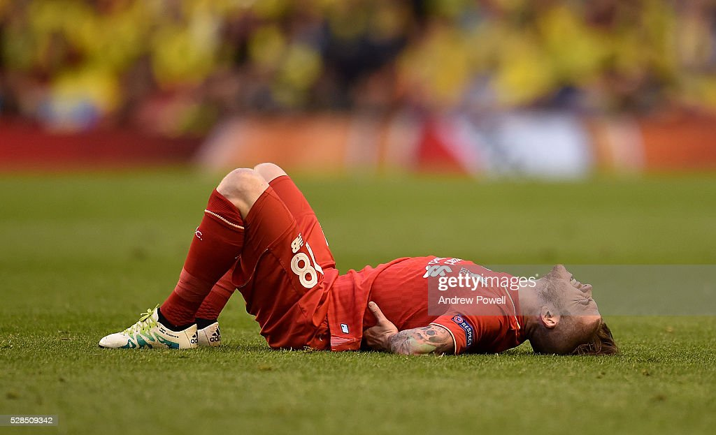 Alberto Moreno of Liverpool feels the pain during the UEFA Europa League Semi Final: Second Leg match between Liverpool and Villarreal CF at Anfield on May 05, 2016 in Liverpool, England.