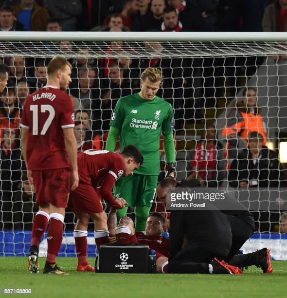 Alberto Moreno of Liverpool goes off injured during the UEFA Champions League group E match between Liverpool FC and Spartak Moskva at Anfield on...