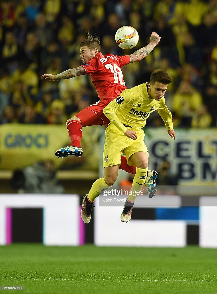 Alberto Moreno of Liverpool goes up with Denis Suarez of Villarreal during the UEFA Europa League Semi Final: First Leg match between Villarreal CF and Liverpool on April 28, 2016 in Villarreal, Spain.