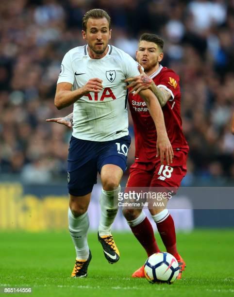 Alberto Moreno of Liverpool holds back Harry Kane of Tottenham Hotspur during the Premier League match between Tottenham Hotspur and Liverpool at...