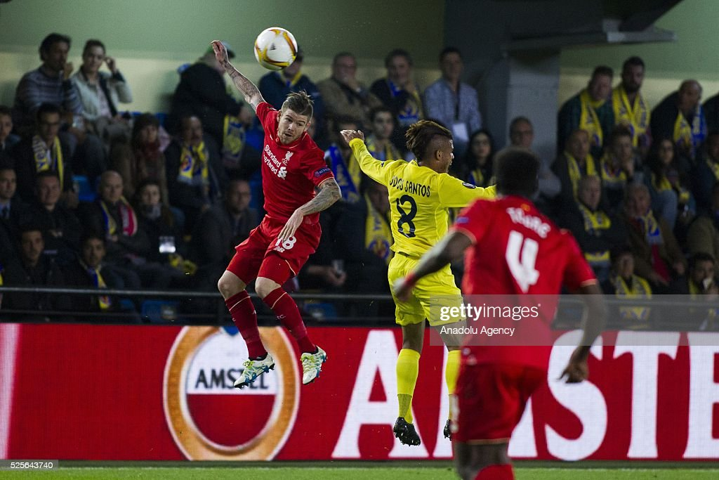 Alberto Moreno (L) of Liverpool in action during the UEFA Europa League Semi Final match between Villarreal and Liverpool at Estadio El Madrigal in Villareal, Spain on April 28, 2016.