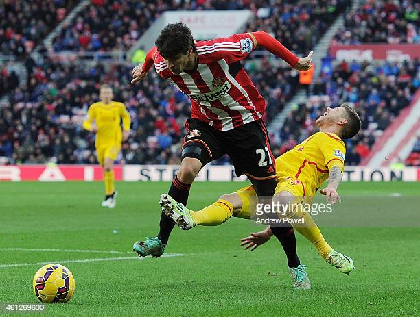 Alberto Moreno of Liverpool is brought down by Santiago Vergini of Sunderland during the Barclays Premier Leauge match between Sunderland and...