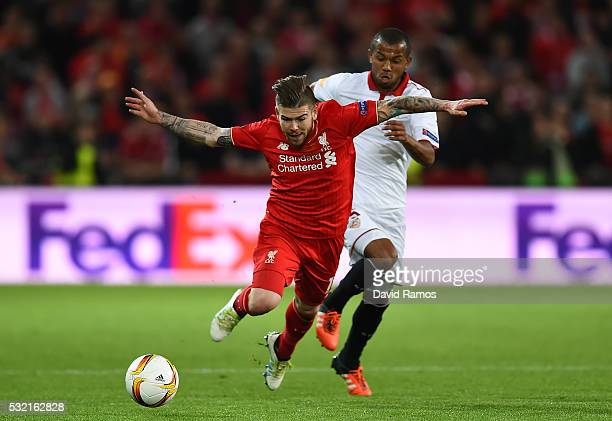 Alberto Moreno of Liverpool is challenged by Mariano of Sevilla during the UEFA Europa League Final match between Liverpool and Sevilla at St...