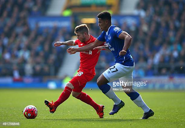 Alberto Moreno of Liverpool is closed down by Tyias Browning of Everton during the Barclays Premier League match between Everton and Liverpool at...