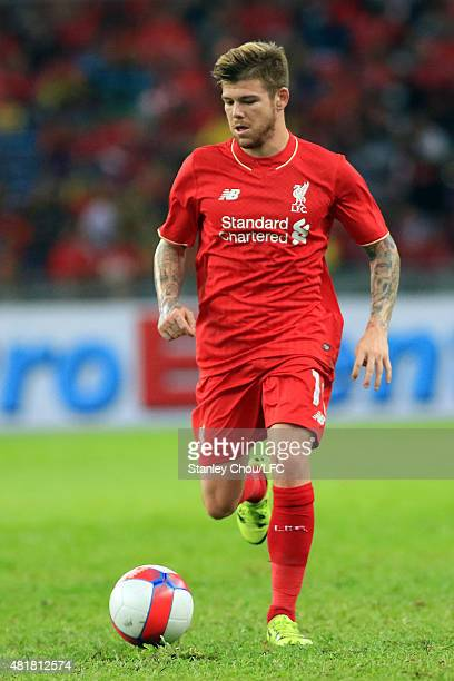 Alberto Moreno of Liverpool runs wiith the ball during the international friendly match between Malaysia XI and Liverpool FC at Bukit Jalil National...