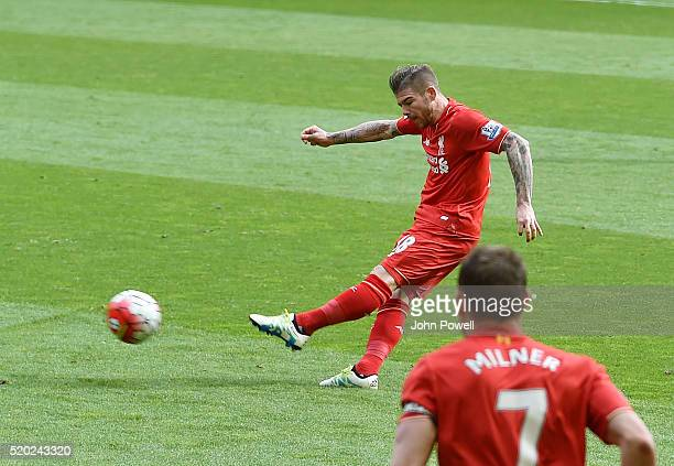 Alberto Moreno of Liverpool scores the opening goal during the Barclays Premier League match between Liverpool and Stoke City at Anfield on April 10...