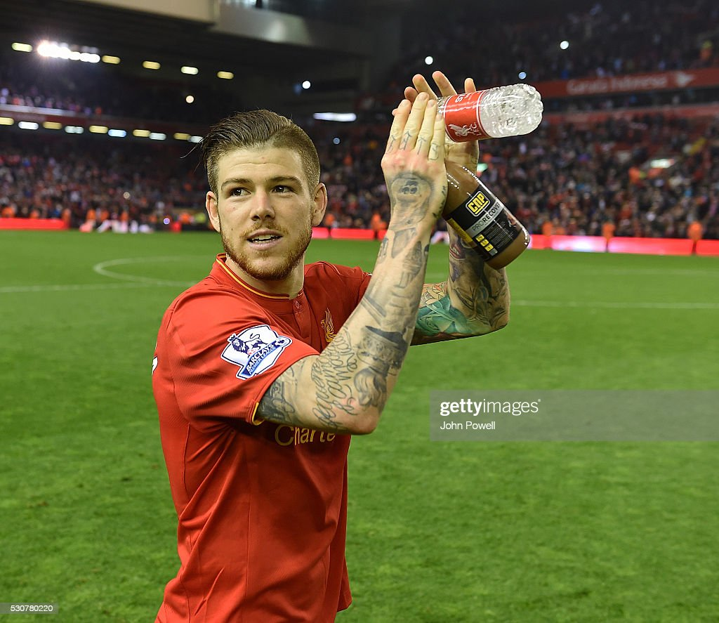 Alberto Moreno of Liverpool shows his appreciation to the fans at the end of the Barclays Premier League match between Liverpool and Chelsea at Anfield on May 11, 2016 in Liverpool, England.