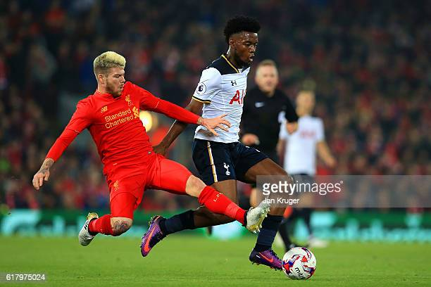 Alberto Moreno of Liverpool tackles Joshua Onomah of Tottenaham Hotspur during the EFL Cup fourth round match between Liverpool and Tottenham Hotspur...