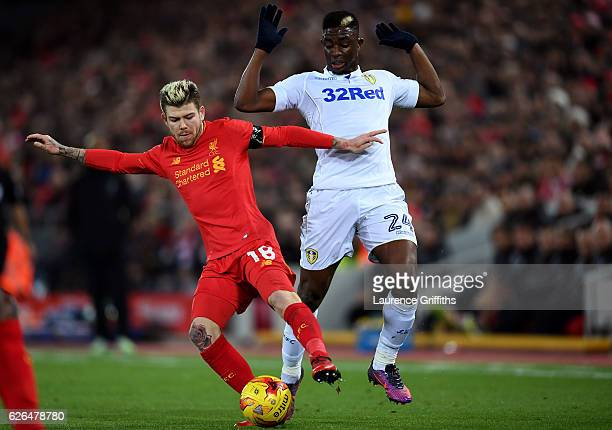Alberto Moreno of Liverpool takes on Hadi Sacko of Leeds United during the EFL Cup QuarterFinal match between Liverpool and Leeds United at Anfield...