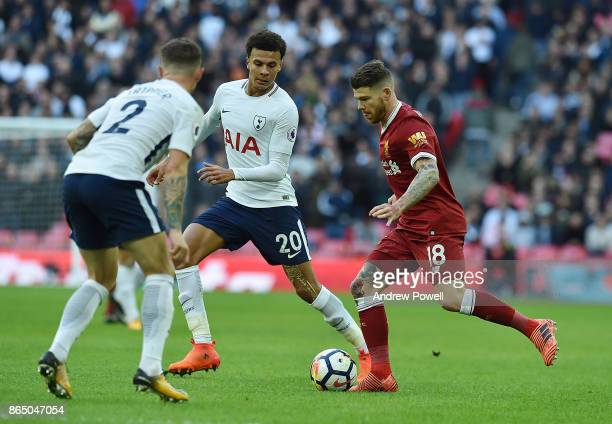 Alberto Moreno of Liverpool with Dele Alli of Tottenham during the Premier League match between Tottenham Hotspur and Liverpool at Wembley Stadium on...