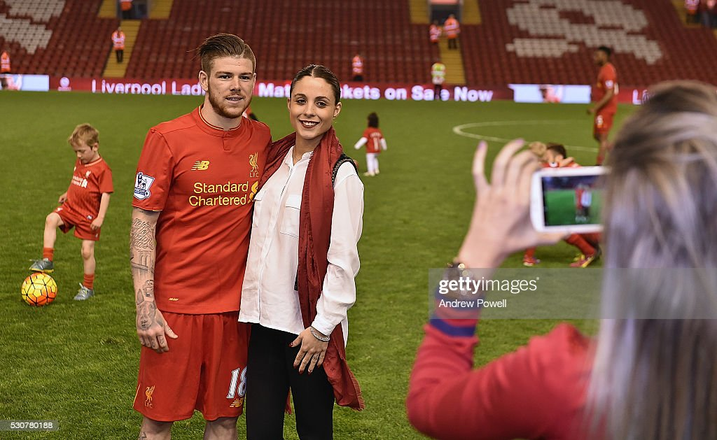 Alberto Moreno of Liverpool with his girlfriend during the Barclays Premier League match between Liverpool and Chelsea at Anfield on May 11, 2016 in Liverpool, England.
