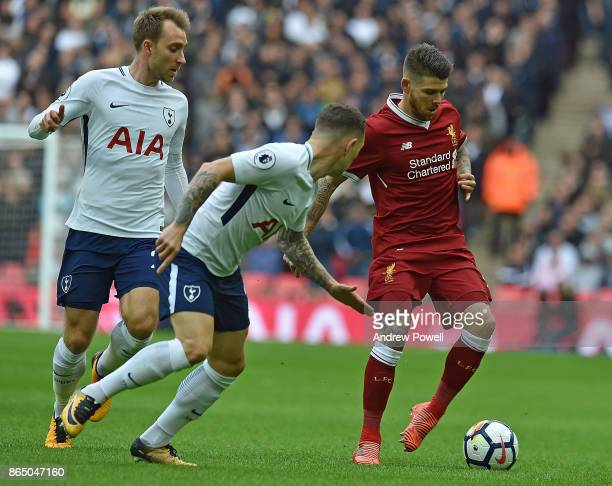 Alberto Moreno of Liverpool with Kieran Trippier of Tottenham during the Premier League match between Tottenham Hotspur and Liverpool at Wembley...