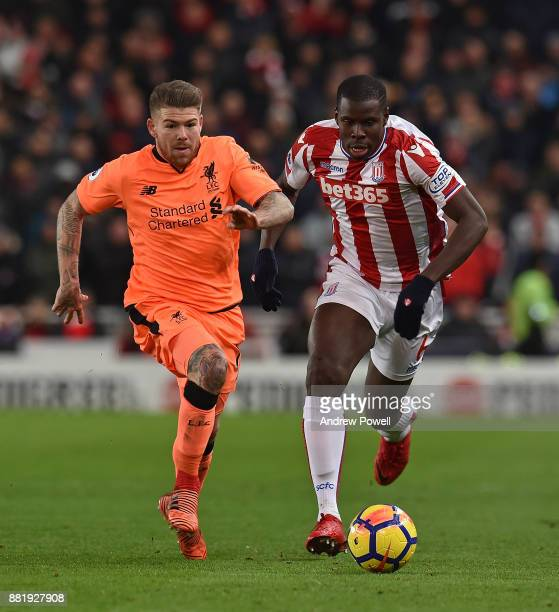 Alberto Moreno of Liverpool with Kurt Zouma of Stoke during the Premier League match between Stoke City and Liverpool at Bet365 Stadium on November...