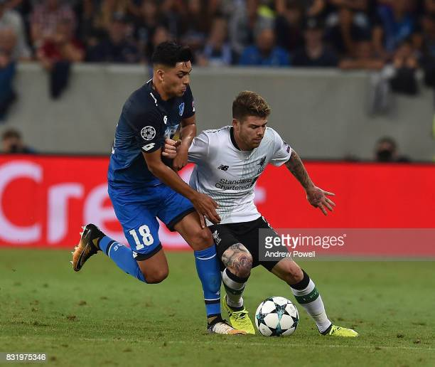 Alberto Moreno of Liverpool with Nadiem Amiri of TSG 1899 during the UEFA Champions League Qualifying PlayOffs Round First Leg match between 1899...