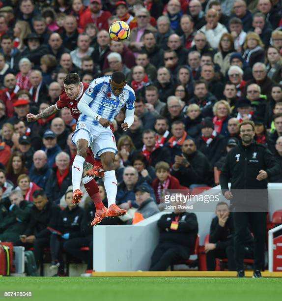Alberto Moreno of Liverpool with Rajiv Van La Parra of Huddersfield during the Premier League match between Liverpool and Huddersfield Town at...