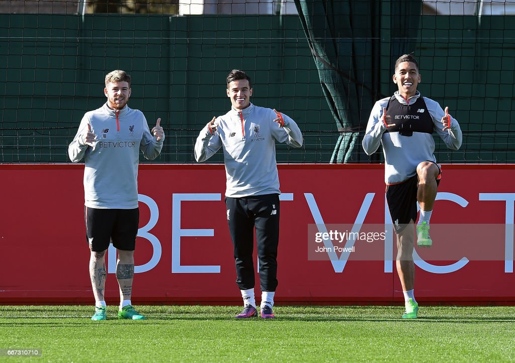 Alberto Moreno, Philippe Coutinho and Roberto Firmino of Liverpool during a training session at Melwood Training Ground on April 11, 2017 in Liverpool, England.