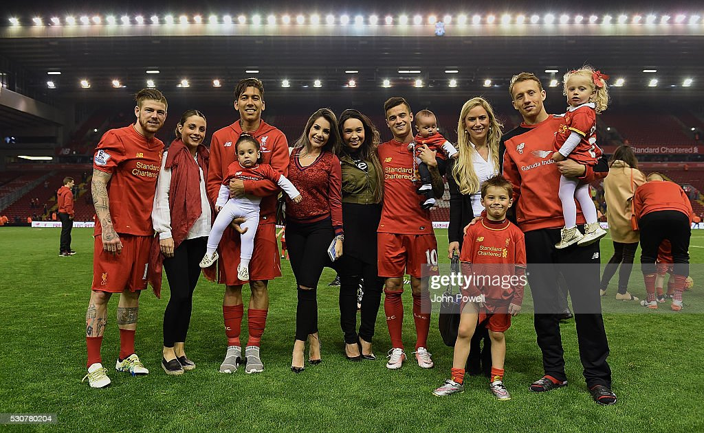Alberto Moreno, Philippe Coutinho, Roberto Firmino and Lucas Leiva and their family at the end of the Barclays Premier League match between Liverpool and Chelsea at Anfield on May 11, 2016 in Liverpool, England.