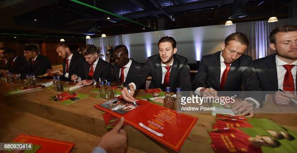 Alberto Moreno Sadio Mane Adam Lallana Lucas Leiva and Simon Mignolet of Liverpool sign autographs during the Liverpool FC Player Awards at Anfield...