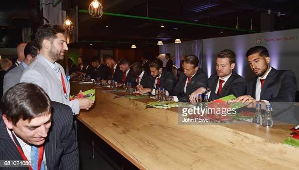 Alberto Moreno Sadio Mane Adam Lallana Lucas Leiva Simon Mignolet and Emre Can of Liverpool sign autographs during the Liverpool FC Player Awards at...