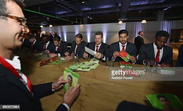 Alberto Moreno Sadio Mane Adam Lallana Lucas Leiva Simon Mignolet Emre Can and Divock Origi of Liverpool sign autographs during the Liverpool FC...