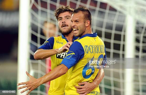 Alberto Paloschi of AC Chievo Verona celebrates the second goal with his team player Riccardo Meggiorini during the Serie A match between AC Chievo...