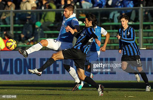 Alberto Paloschi of AC Chievo Verona competes for the ball with Giuseppe Biava of Atalanta BC during the Serie A match between Atalanta BC and AC...