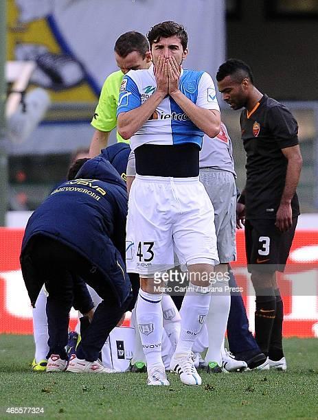 Alberto Paloschi of AC Chievo Verona reacts as his teamate Federico Mattiello of AC Chievo Verona is injured during the Serie A match between AC...