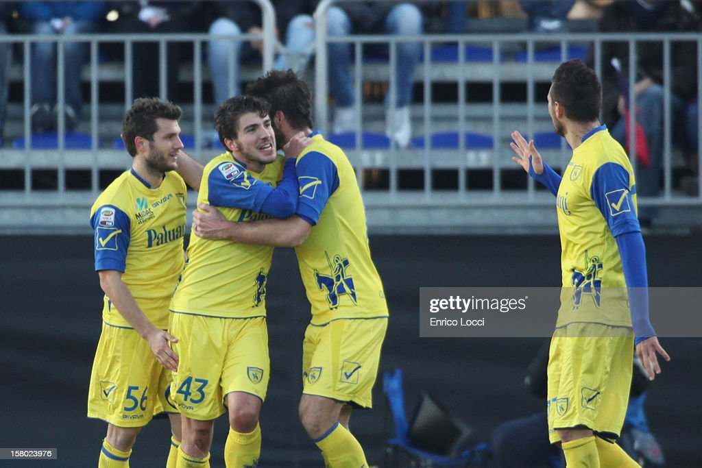 <a gi-track='captionPersonalityLinkClicked' href=/galleries/search?phrase=Alberto+Paloschi&family=editorial&specificpeople=3817495 ng-click='$event.stopPropagation()'>Alberto Paloschi</a> (2nd L) of Chievo celebraties with team-mates after scoring the opening goal during the Serie A between Cagliari Calcio and AC Chievo Verona at Stadio Sant'Elia on December 9, 2012 in Cagliari, Italy.